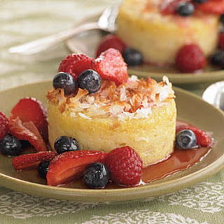 Coconut-Crusted Polenta Cakes with Triple Berry Sauce.