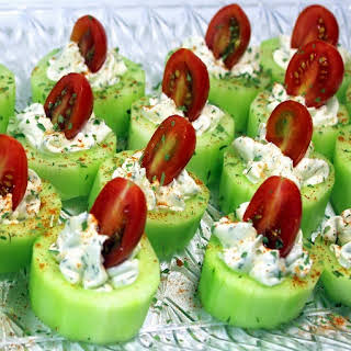 Cucumber Bites with Herb Cream Cheese and Cherry Tomatoes.