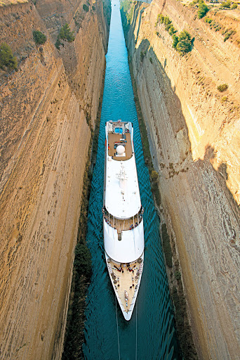 Tere-Moana-Corinth-Canal-Greece - Slim and trim, Tere Moana passes through the Corinth Canal in Greece. Try that, Quantum of the Seas!