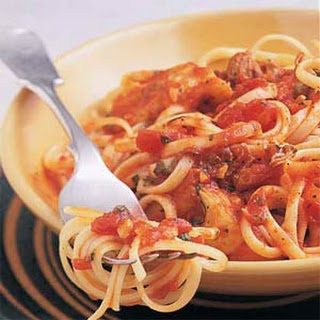 Linguine with Clams and Artichokes in Red Sauce.
