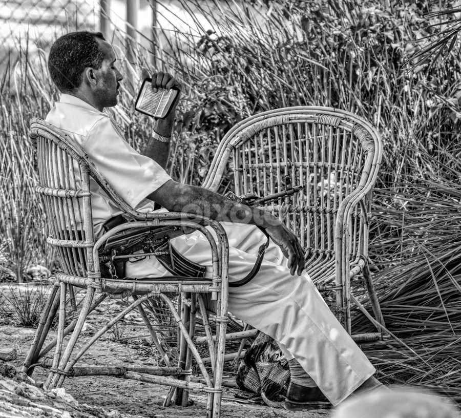 On guard by Vibeke Friis - Black & White Street & Candid ( chair, on guard, sitting, guard, egypt, gun, ak47, man,  )