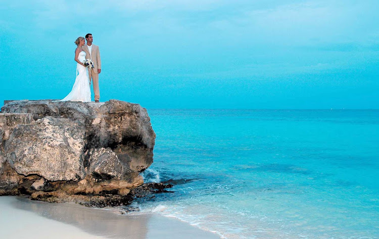 A just-married couple at Playa Azul on the island of Cozumel, Mexico.
