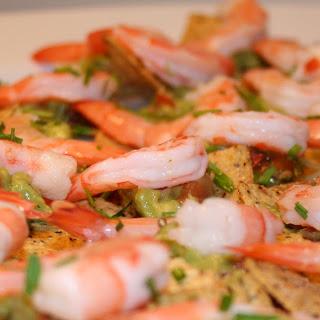Avocado & Shrimp Topped Multigrain Tortilla Chips.