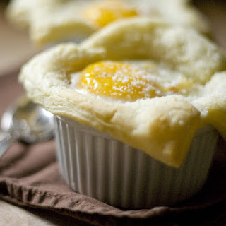 Baked Eggs with Potatoes in Puff Pastry Cups.