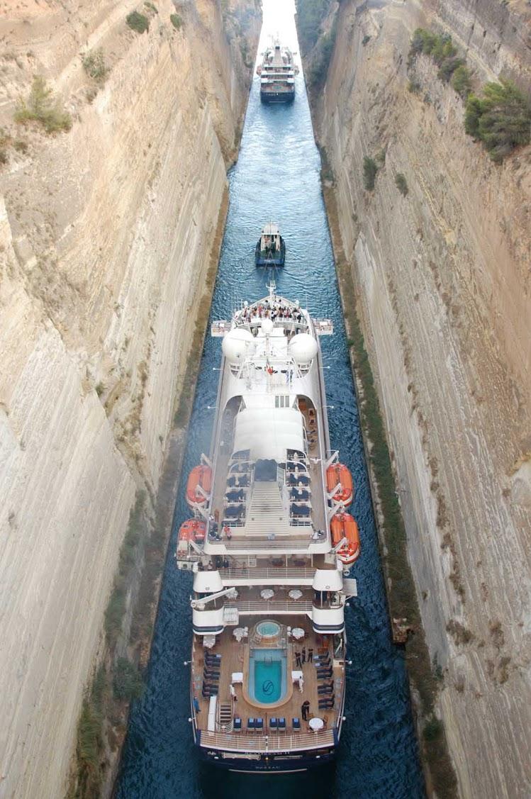 SeaDream I and SeaDream II squeeeeze through Greece's Corinth Canal in the Aegean Sea.