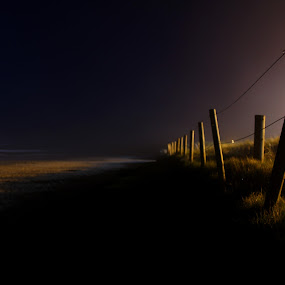 Lonely path by Ruari Plint - Landscapes Beaches ( fence, sea, low light, beach, nightscape,  )