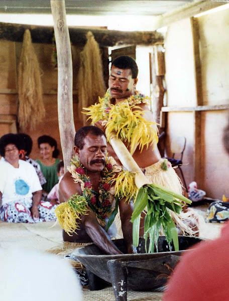 The ceremonial mixing of kava, made from the crushed root of the pepper plant, in Namuamua, Fiji.