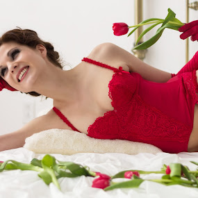 A lady in red by Vikram Mehta - People Portraits of Women ( pillow, red, lingerie, bright, bed, woman, roses, corset, white, lady, gloves, smile )