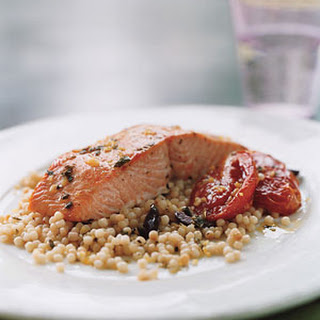 Wild Salmon with Pearl Couscous, Slow-Roasted Tomatoes, and Lemon Oregano Oil.