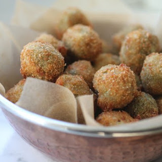 Spicy Cheese-Stuffed Fried Olives.