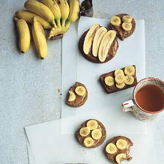 Almond Butter and Finger Bananas on Fruit Bread.