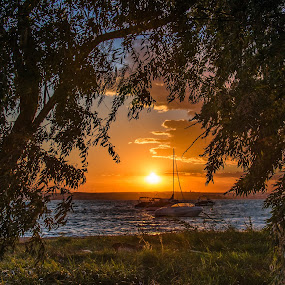 quiet sunset by Lupu Radu - Landscapes Sunsets & Sunrises ( sunset, boats, romania, lake, constanta, mamaia, , relax, tranquil, relaxing, tranquility )