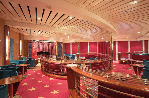 Jewel-of-the-Seas-Hollywood-Odyssey - If you're a smoker, head to Jewel of the Seas' Hollywood Odyssey, a cigar lounge with a cozy atmosphere and live entertainment.
