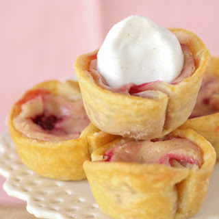 Red and Golden Raspberry Lemon Baby Cheesecake Pies.