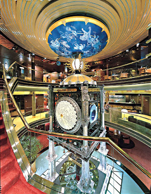 At the heart of ms Amsterdam is the Planeto Astrolabium, a commissioned signature sculpture soaring in a three-story atrium that tracks constellations, the planets, world time and ship time.