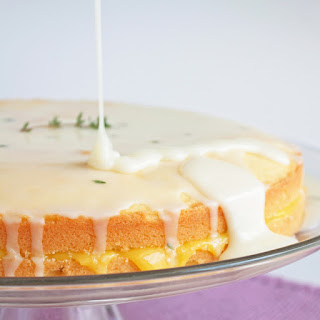 Limoncello Pound Cake w/ Meyer Lemon Curd Filling & Goat Cheese, Thyme and Limoncello Icing.