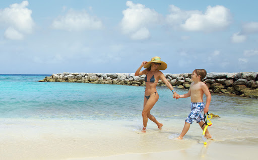 beach-stroll-Aruba - Head to Aruba for some fun with the family.
