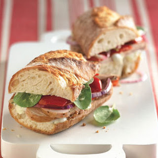 Roast Pork Sandwiches with Sweet Peppers and Arugula.