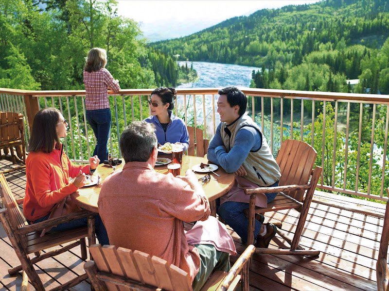 At the Kenai Princess Wilderness Lodge in Cooper Landing, Alaska, you can hang out on the deck and take in scenic views of Kenai River valley.