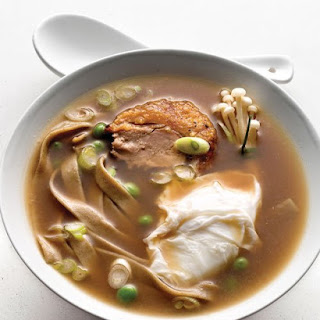 Steamy Bowl of Noodles with Poached Duck Egg, Scallions, and Mushrooms.