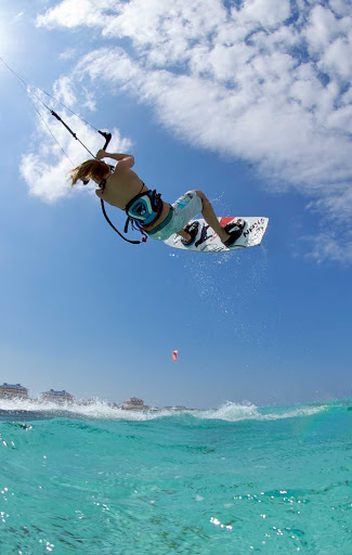 Kitesurfing — sometimes called kiteboarding or sailboarding — in the Cayman Islands.