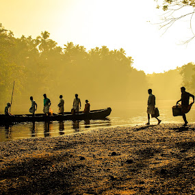 A day in Kerala, India by Bruno Rosali - Landscapes Sunsets & Sunrises ( backlight, back water, silhoutte, india, kerala, yellow, transportation, sunrise, boat, people,  )