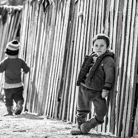 The lord of the country-road... by Diana Toma - Black & White Portraits & People ( fence, poverty, boys, country-road, children, rural )