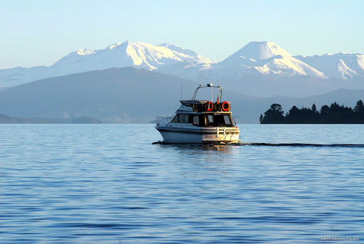 "Cruising_Lake_Taupo - In any season, cruising on Lake Taupo will allow you to appreciate the awesome grandeur of the North Island's volcanic region. To the south you'll see the giant volcanoes of Tongariro National Park. Beneath you is the Taupo caldera, one of the world's few ""super volcanoes,"" which last erupted about 1,800 years ago."