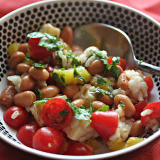Pinto Bean and Rice Salad With Tomatoes and Cheddar in Banana Pepper-Chili Vinaigrette.