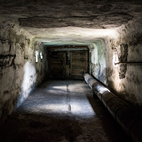 Inside the mine.  by Suciu Corina - Buildings & Architecture Other Interior ( inside, door, mine, light, pipe,  )