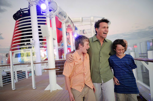 "Disney-Dream-Father-Sons-on-Deck - A father with his sons on the deck of Disney Dream. Disney ships have won a raft of ""best for families"" awards from Travel + Leisure, Conde Nast Traveler, Porthole Magazine readers and the Cruise Critic Cruisers' Choice Awards."