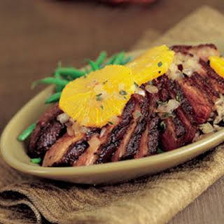 Coriander-Rubbed Duck Breasts with Glazed Oranges.