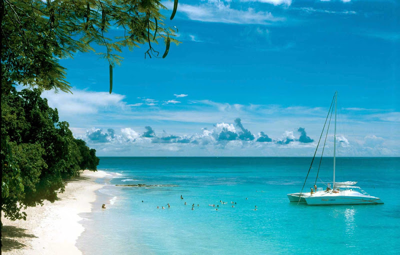 A catamaran whisks passengers to a secluded beach on Barbados.