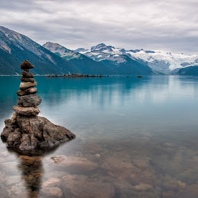 Rock Piles by James Wheeler - Landscapes Waterscapes ( shore, calm, nobody, pebble, reflection, mountain, peak, stability, stone, rock, vibrant, travel, beauty, landscape, tranquil, balance, sky, nature, pile, pristine, black, british columbia, garibaldi park, clouds, water, stacked, whistler, peaceful, symbol, canada, green, beautiful, lake, forest, tourism, relaxation, scenic, destination, blue, sunset, peace, outdoor, zen, summer, tranquility, stack, natural, hike )