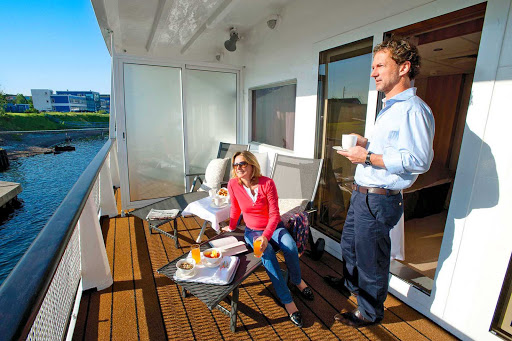 Viking-River-Cruises-couple-on-veranda - Spend your morning soaking in the views with a continental breakfast on your private veranda aboard your Viking Cruises ship during her sailing in Russia.