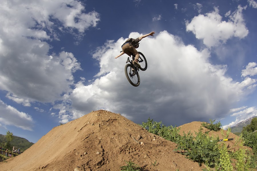 No Handed Tuck by Logan Mccarthy - Sports & Fitness Cycling ( clouds, steamboat, biking, colorado, bmx, contest, dirt jump, bike, photo, camera, jump, steamboat springs )