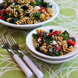 Whole Wheat Pasta Salad with Fried Kale, Tomatoes, Olives, Feta, and Pesto Vinaigrette.