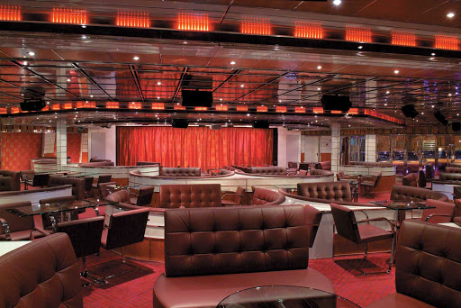 Carnival-Freedom-International-Lounge - When cruising the Caribbean on Carnival Freedom, stop in at the International Lounge for an evening of live music, karaoke and late-night comedy.