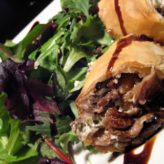 Wild Piedmont Mushroom & Goat Cheese Strudel served over Spring Arugula with toasted Pine Nuts