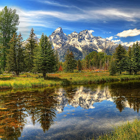 Schwabachers Landing by John Larson - Landscapes Mountains & Hills ( water, sky, grass, mountains clouds, reflections, trees )