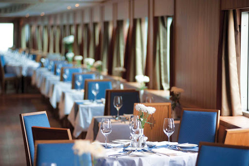 Viking-River-Cruises-Dining-Room - Experience intimate dining with scenic views and good company in the restaurant aboard your Viking River Cruises ship during your exploration of Russia.
