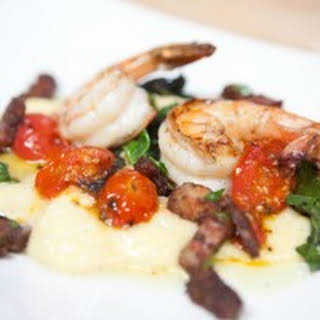 """Deconstructed Roasted Tomato Grits and Shrimp, with Sauteed Baby Mustard Greens and Bacon """"Confit""""."""