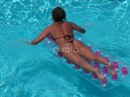 Swimming Pool Floating Girl By Rob K