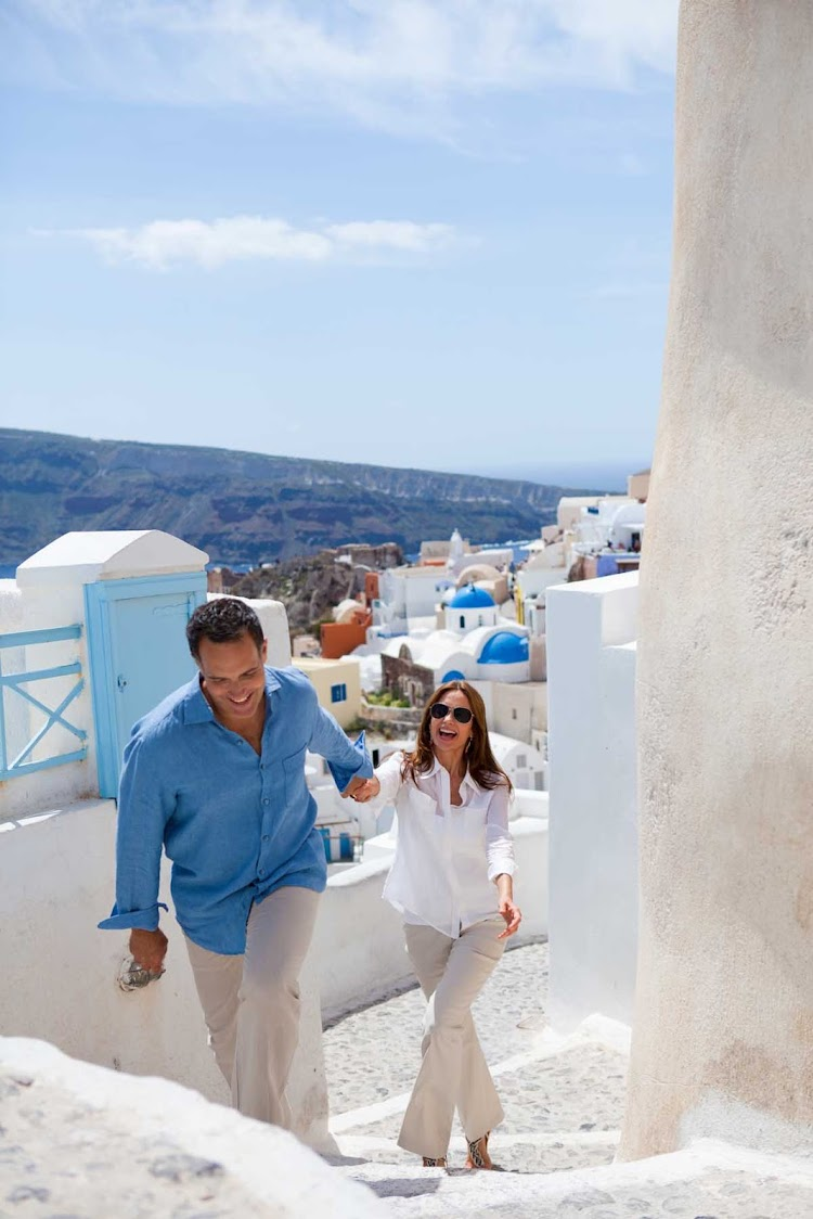 Stepping through the cobblestone walkways and sugar-cube city of Oia during Seven Seas Mariner journey to the Greek islands.