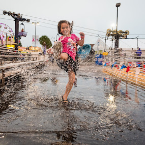 Rained Out Show Won't Stop The Fun by Russell McFarland - Babies & Children Children Candids ( water, splashing water, splash, children, children candids, fun, splash water photography, state fair, fair, rain )