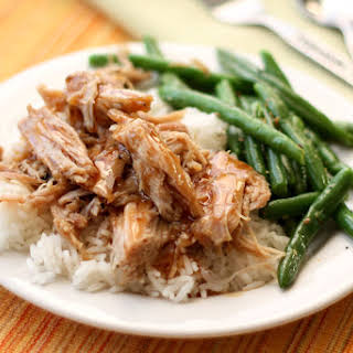 Slow Cooker Pork Roast with a Tangy Glaze Sauce.