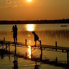 Minnesota Summer Fun, Sunset Wolf Lake by Kathleen Koehlmoos - People Family ( wolf lake, minnesota, dad with kids, wolf lake minnesota, sunset, beautiful sunset, pier, family fun, sunset pier )