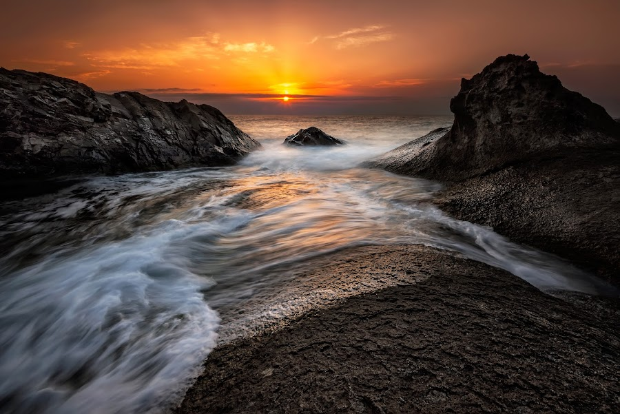 Dawn among the rocks by Evgeni Ivanov - Landscapes Waterscapes ( stone, rock, beach, vibrant, coastline, landscape, sunliht, sky, nature, long exposure, bulgaria, water, clouds, orange, reef, sea, cloudscape, scenic, gray, rezovo, sunset, background, wave, summer, sunrise )