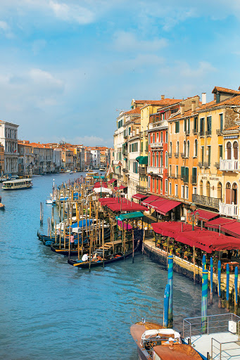 Venice-waterfront - Cafés, hotels and homes along the Grand Canal of Venice, one of the memorable stops aboard a Tere Moana cruise.