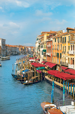Cafés, hotels and homes along the Grand Canal of Venice.